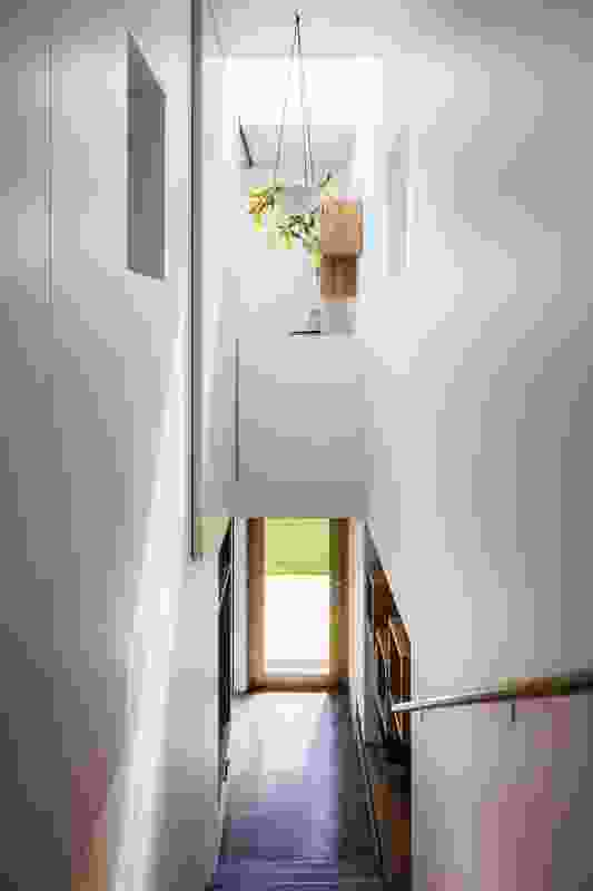 The stairwell brings light into the centre of the house and provides a visual connection with the garden below.