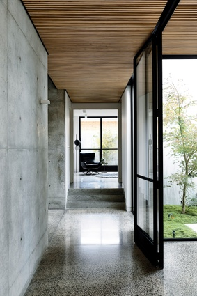 The timber battened ceiling offsets the cool tones of the concrete and softens the space.