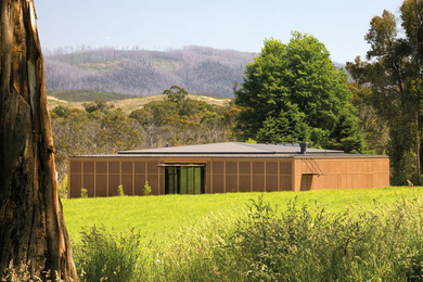 The Narbethong Community Hall, by BVN and Arup and a number of consultants working pro bono, replaced a centre that was destroyed in the Black Saturday fires in 2009. The hall is wrapped in a bronze mesh fire-resistant screen
