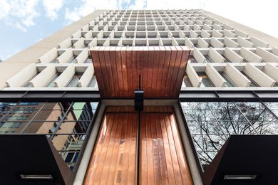 Two-part copper and timber doors, based on a Mexican cathedral, make for a grand and dramatic entry to the QT Melbourne hotel.