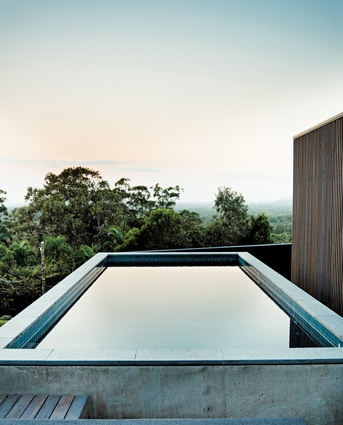 An off-form concrete pool offers elevated views over the eucalyptus forest to the south.