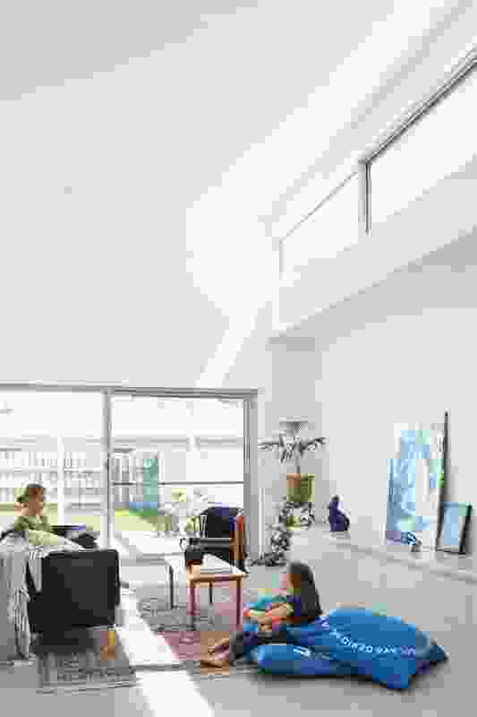 The new home provides generous light-filled volumes. Artwork: Annabelle Aronica, Sean Bailey.