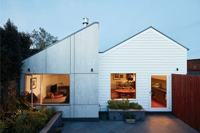 "The raw-finish cement sheet cladding on the new volume was chosen for its ""honesty"" and the contrast it provides to the weatherboard of the original home."