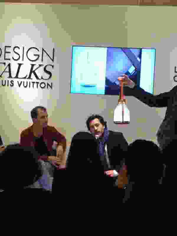 Designer talks at the Louis Vuitton boutique.