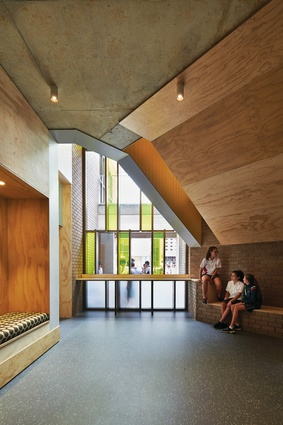 Coarse plywood, patchworks of colour and plentiful nooks are a welcome antidote to the ubiquity of sterile classrooms.