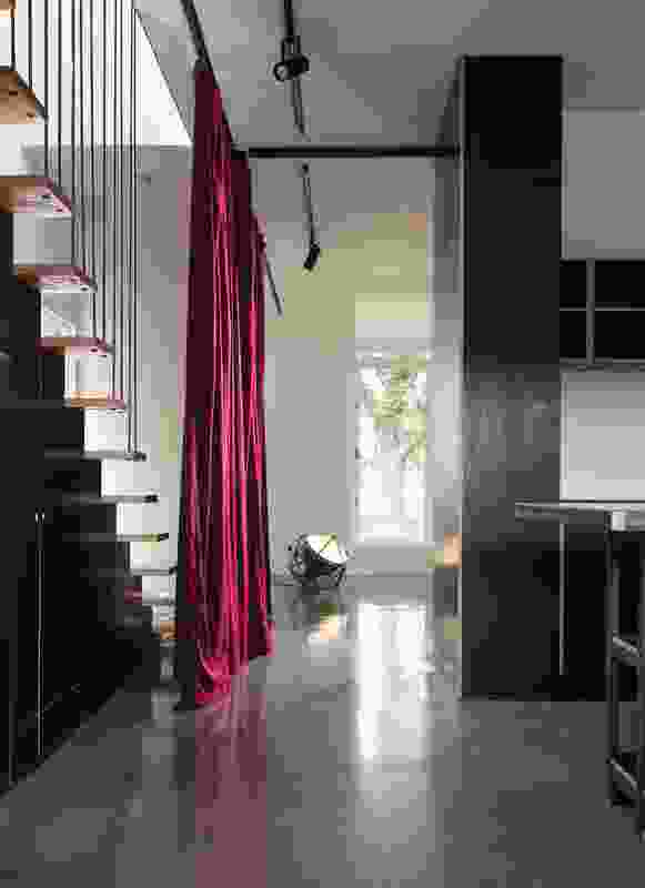 The floor-to-ceiling red velvet curtain can be used to divide up the ground-floor living area.