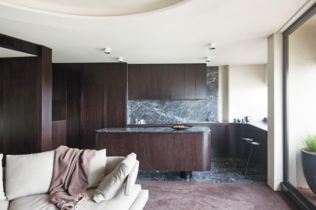 The kitchen is the sculptural centrepiece of the space, with all harsh edges softened into curves.