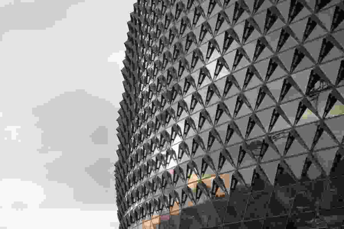 Inspired by the skin of a pine cone, the building's triangulated dia-grid facade responds to its environment like a living organism.