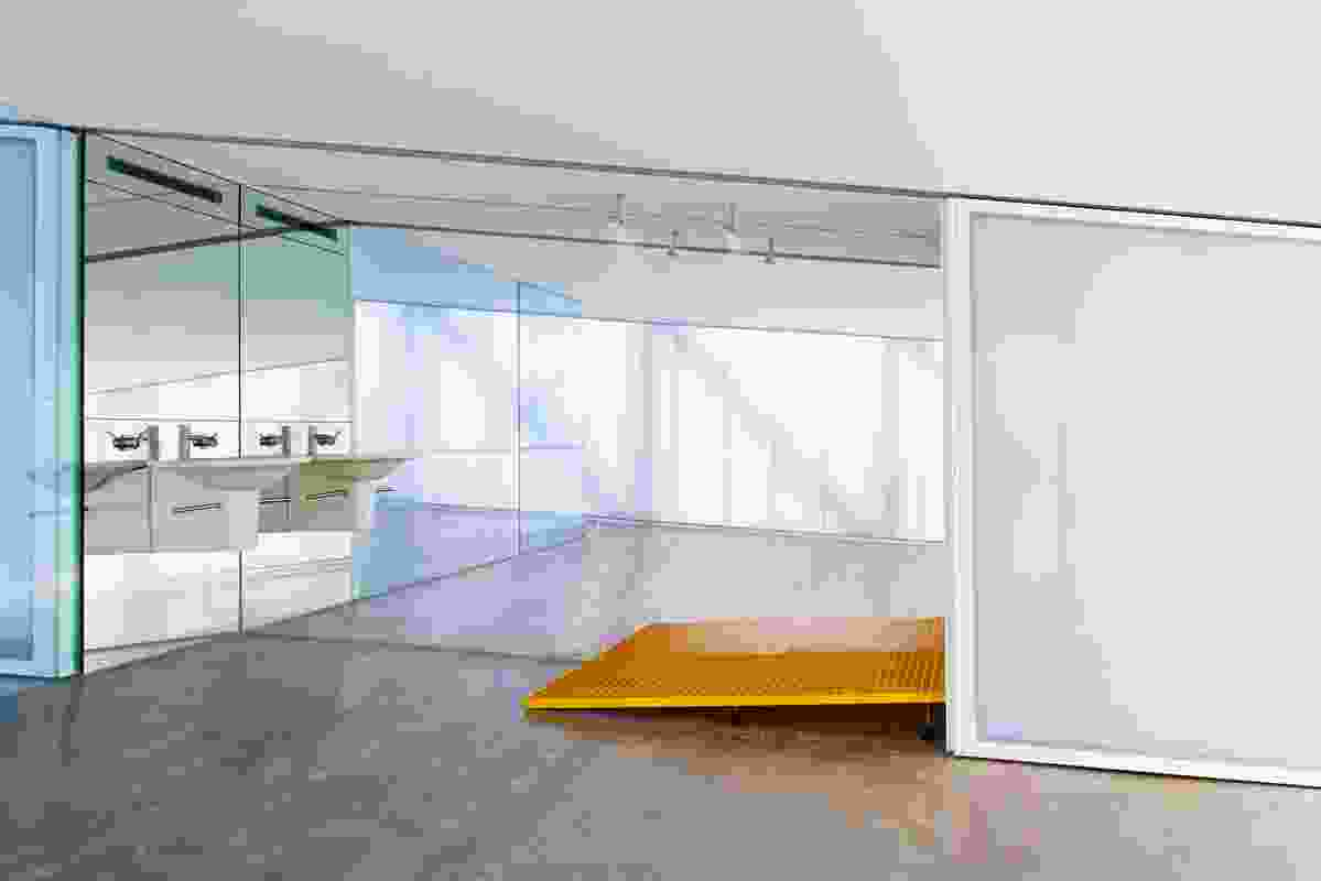 Polycarbonate sliding doors pull back to reveal all services, including the narrow bathroom.