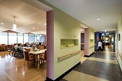 View of the entry to the Sorrento Ward. In both wards patients and visitors walk past the lively space of the dining room before reaching the nurses' station and rooms. Image: John Gollings