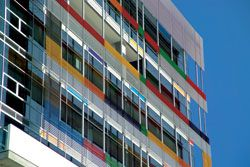 Facade detail. The colourful facade is designed to reflect the diversity within.