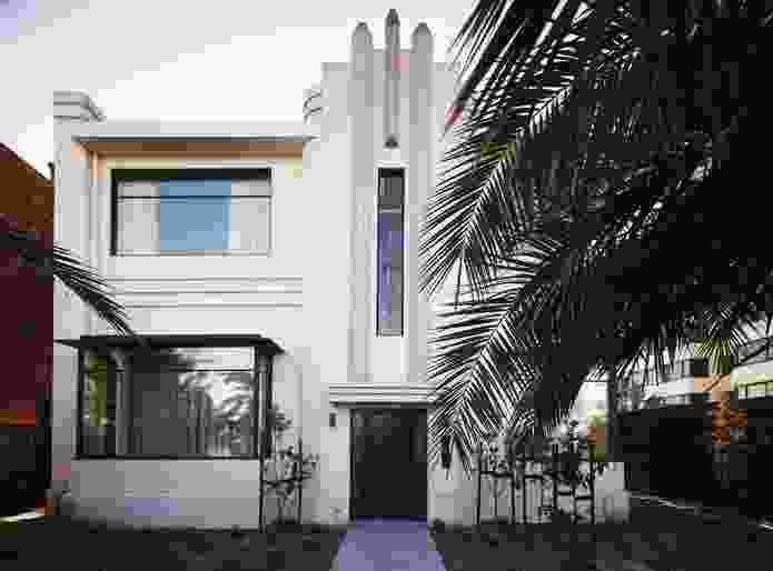 """A new front door framed by De Stijl-esque windows added to the """"Hollywood"""" facade."""