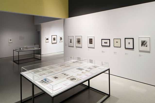 Framed photographs, publications posters on display.