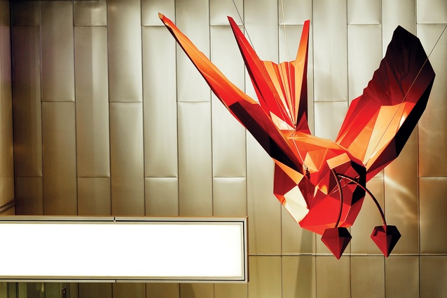 Sculpture by James and Eleanor Avery of a swallow in red aluminium hangs above reception.