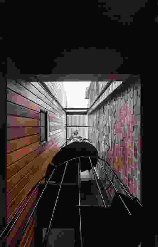A vertiginous spiral staircase provides vertical circulation for the house.