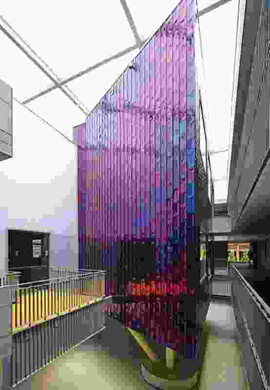 The brightly coloured hub is a purposeful juxtaposition to the rest of the building, where calming shades of grey and beige predominate.
