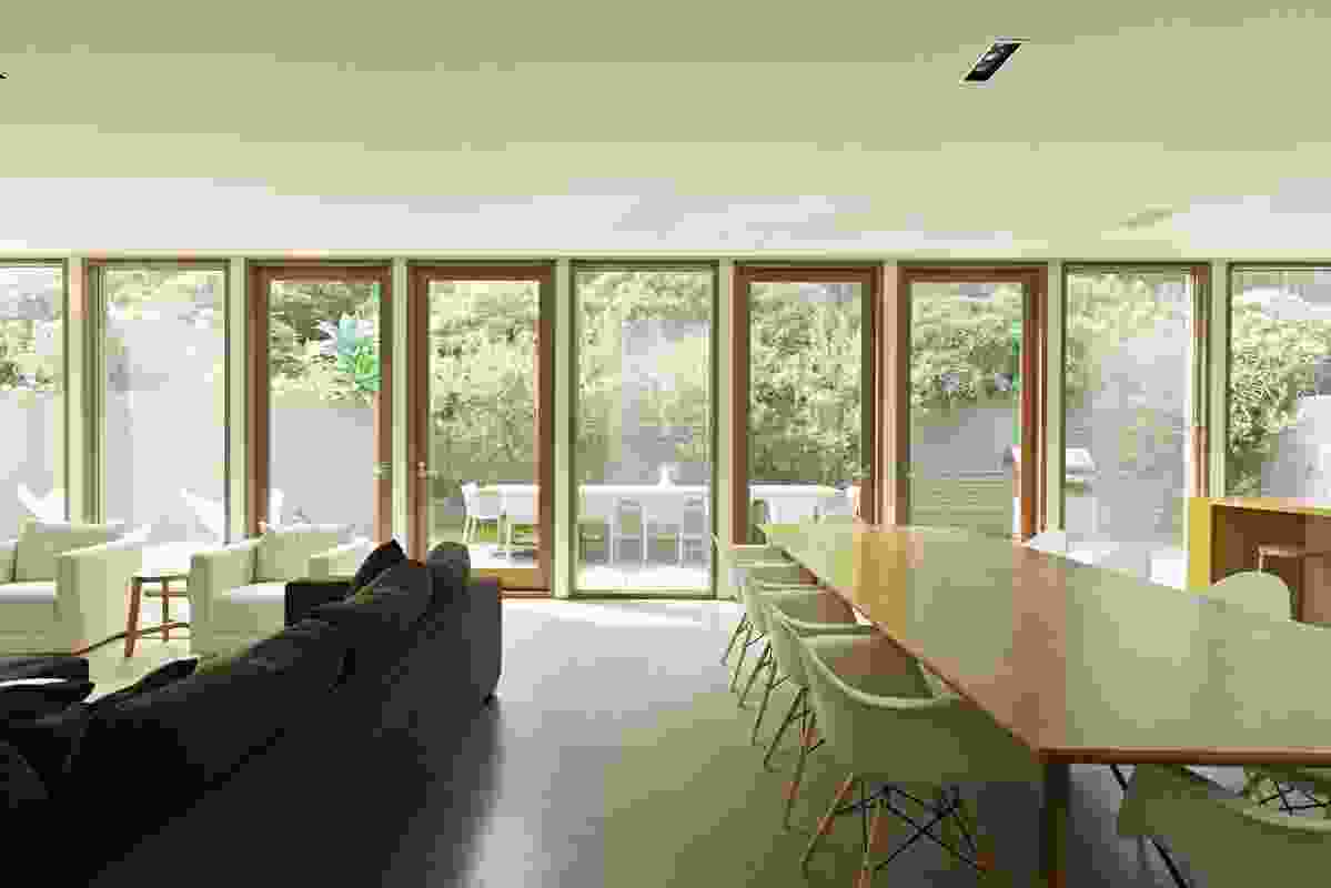 The north-facing living space is lined with full-height windows.
