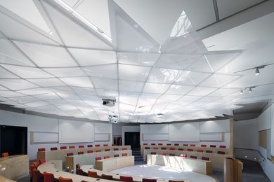 The lecture theatre has a hemicycle plan, which allows seating and sight lines to encourage a high level of physical interaction and visual connection.