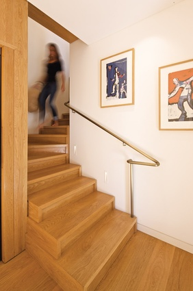 A detailed American oak staircase leads to the lower level.