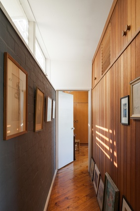 Many of the internal walls are lined with unpainted vertical joint timber boards.