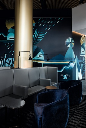 The black bluestone-lined lift lobby is flanked by a dramatic in situ artwork by local artist Al Stark.