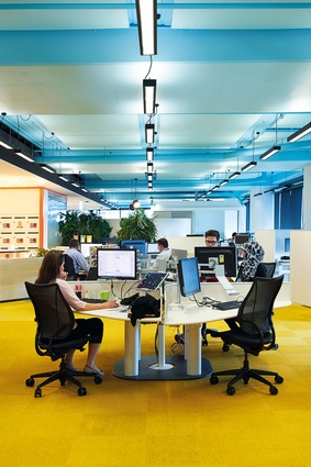 Staff can select from more than twenty- six work settings, from collaborative hubs to quiet indoor spaces.