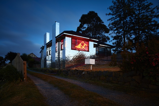 <i>Untitled House</i> by Roh Singh, Larry Parkinson and Morganna Magee includes a neon drawing of a tent on the exterior.