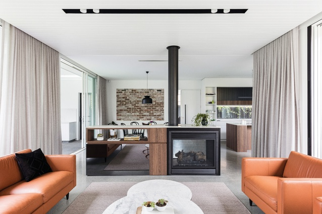 Materials such as polished concrete and black cedar complement the texture and detail of the original house.