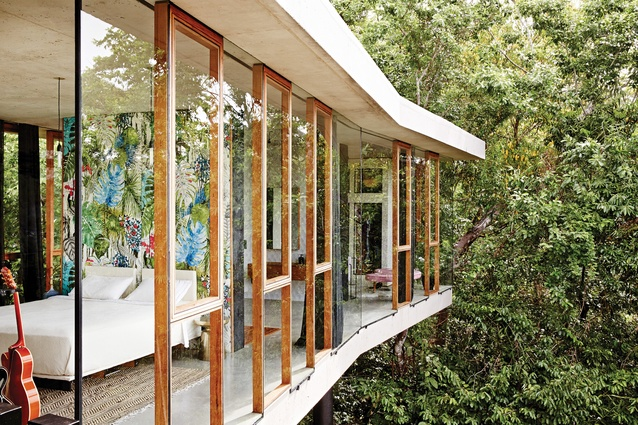 The main bedroom wing launches itself into the surrounding rainforest.