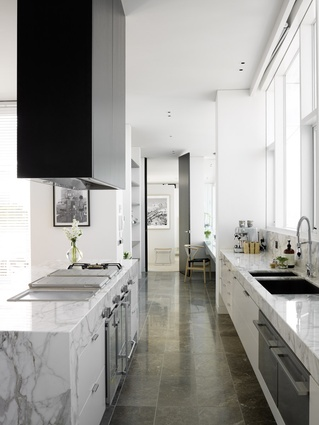 """The """"envy-inducing"""" kitchen is composed of high-end appliances and cuisine-specific fittings inset into tasteful marble benchtops."""