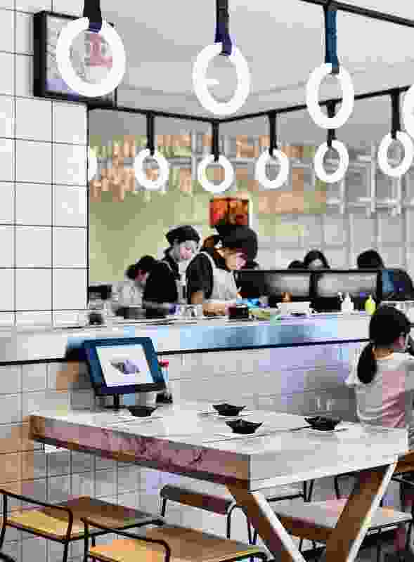 The sushi train's restrained simplicity and sense of stillness give it its strength of character.
