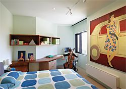 The children's bedrooms are demarcated from the quasi-public domain of most of the house, but still hung with art. Artwork: Jon Campbell, Spearmint Baby, 1989. Image: Dianna Snape