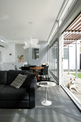 """The rear extension is like an """"enclosed interior,"""" with a north-facing living room and kitchen that is separated from the courtyard by a strip of bifold doors."""