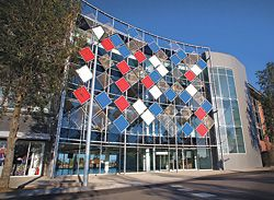 Whitten Oval, redevelopment by Peddle Thorp – a tensile net of lightweight panels and cables provides a transparent facade. Photograph Jesse Spezza.