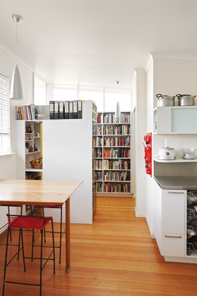 The original 1950s back porch is now a small library off the kitchen.