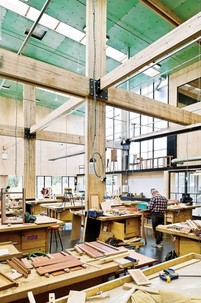 The new fine furniture workshop is housed in a double-height volume at the north end of the new shed.