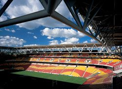 The colours of the Broncos rugby league team are reflected in the stadium seating.