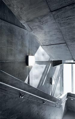The stair extends the striking use of concrete.