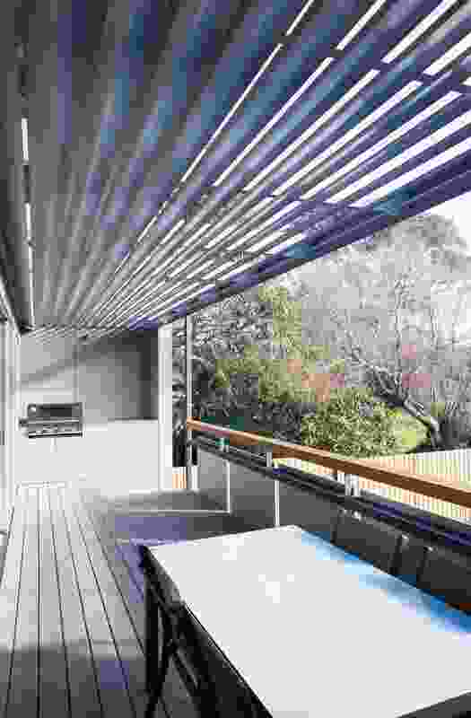 Overhead louvres to the north-facing verandah screen the sun in summer and allow it in during winter.