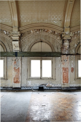 Years without maintenance have left the ballroom in decay, with decorations falling from the ceiling and the parquetry floor peeling.
