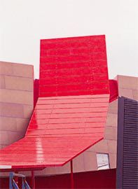 The red steel, looping canopy, a visible manifestation of the string, coming out of the Temporary Gallery.