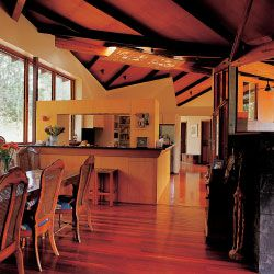 The O'Rorke-Graham House. View over the dining room. The living spaces are each subtly affected by the shape and the character of the roof.