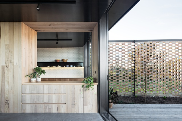 Taking cues from Harry Seidler's Rose Seidler House in Sydney, the servery connects the kitchen to the living areas.