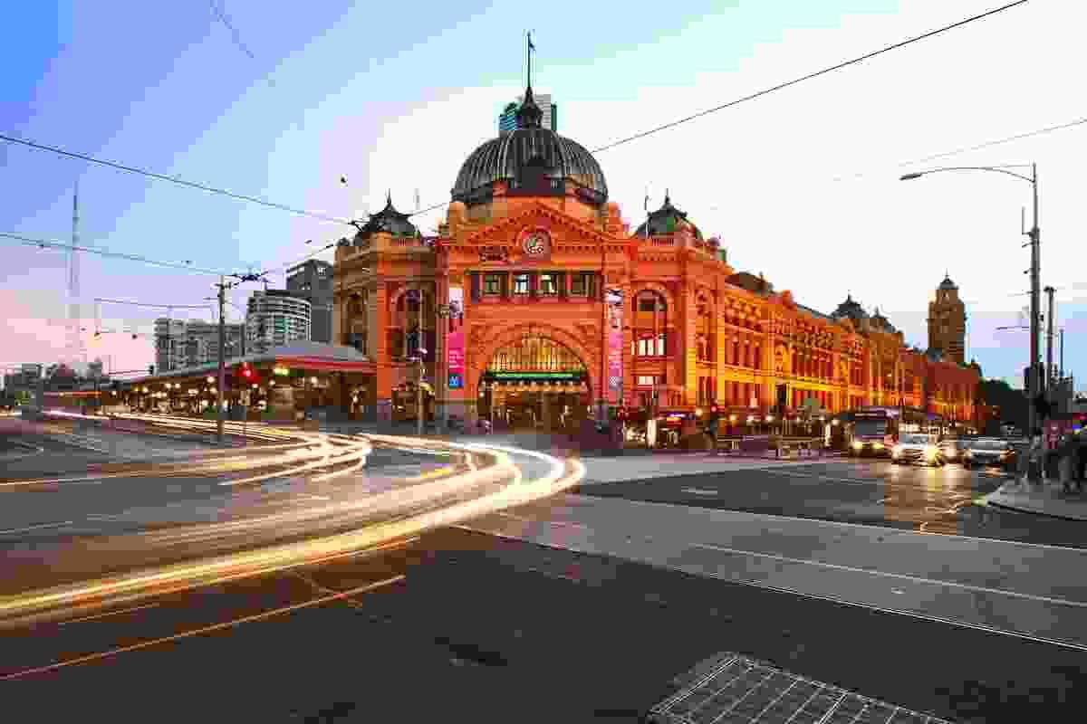 Flinders St Station at dusk.