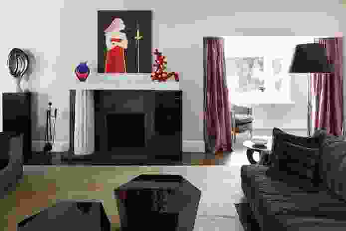An asymmetrical marble fireplace is featured in the drawing room. Artworks L–R: Joel Elenberg (sculpture), Vivienne Shark Lewitt (painting), Siobhan Ryan (red sculpture).