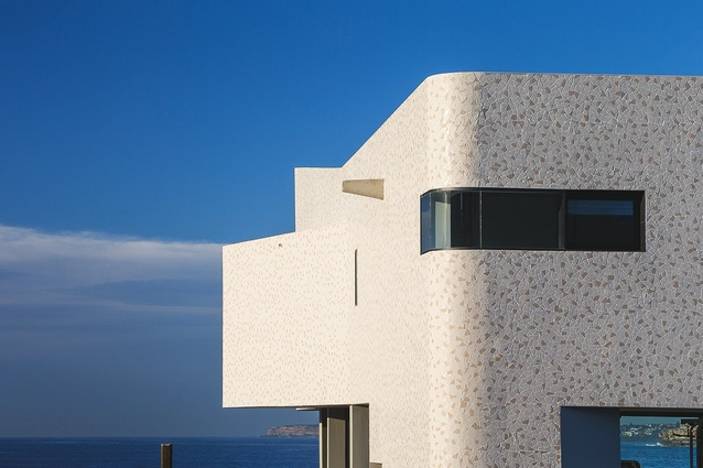 The tiled armature is pierced with views from street through to ocean.