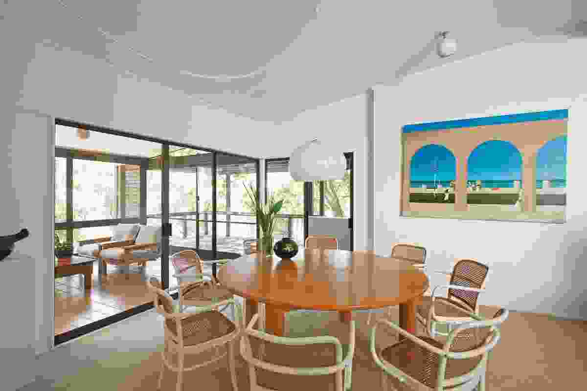 View through the living spaces to the sunlit landscape beyond. Artwork: James Willebrandt.
