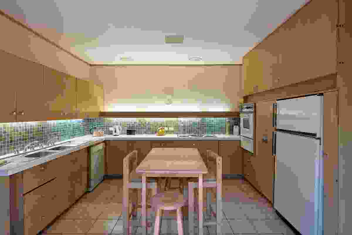 The kitchen is a contained unit that forms the core of the house.