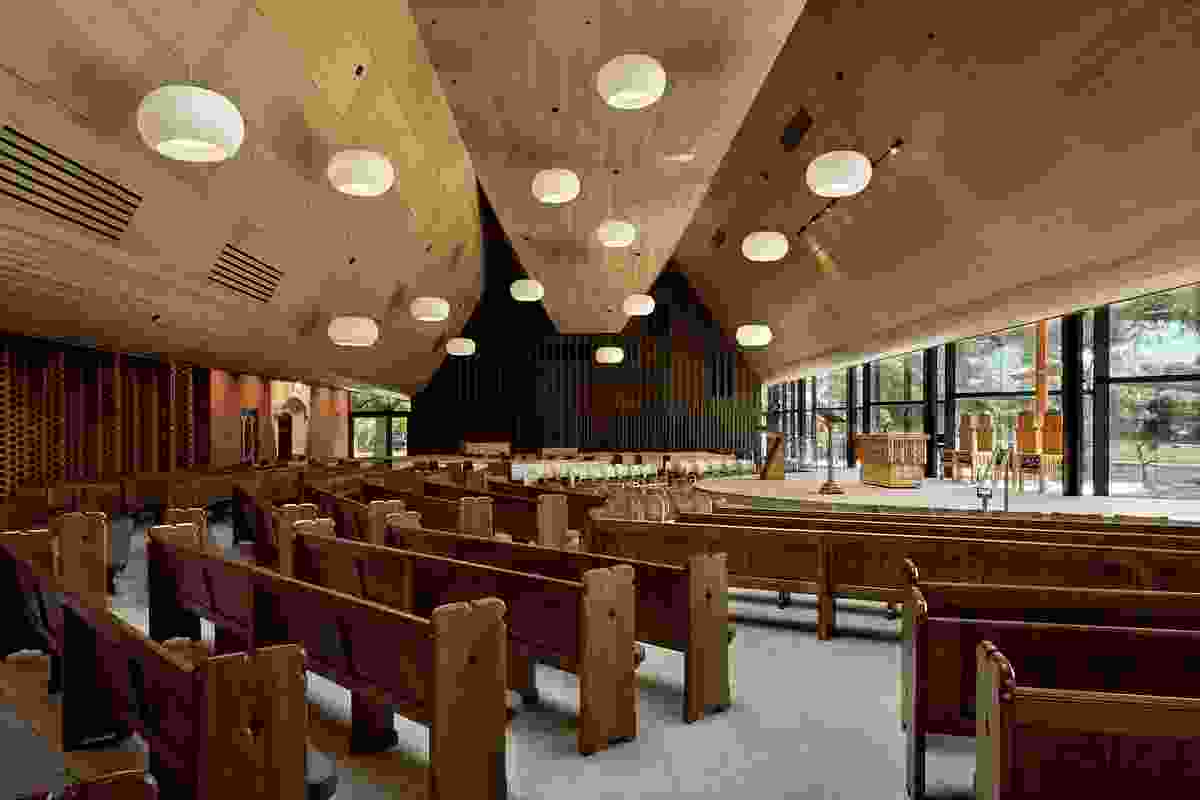 The overall organization of pews and seats is arranged as a collection of seating groups, placing an intermediate scale between the individual and the group.