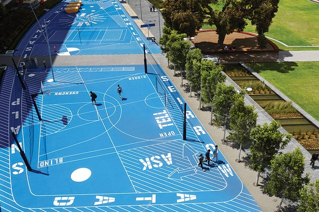 The sweeping blue form of The Scheme by Gothe-Snape is delineated by white stripes and letters – integrating public art with recreational facilities.
